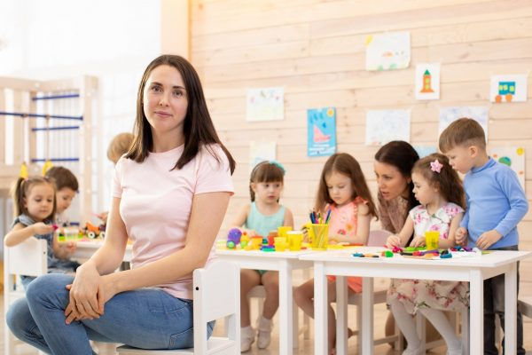 early education centre manager with kids during class