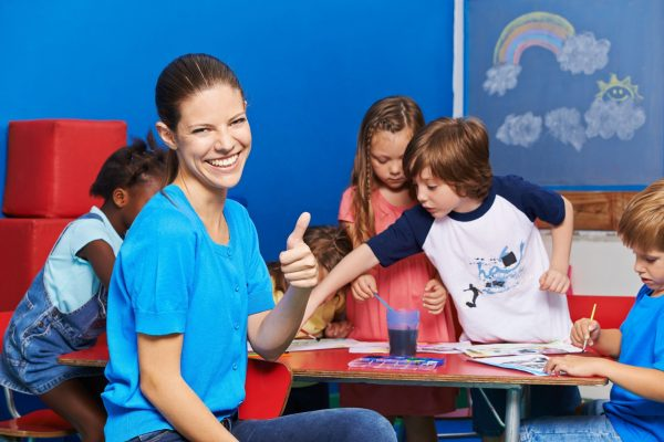 female child care worker job:  using play equipment to enjoy with children