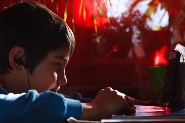 child concentrating with music